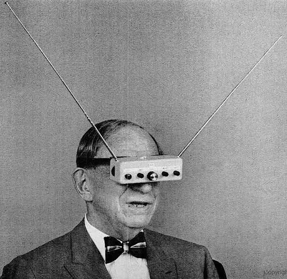 a photograph of 1963 television glasses strapped to a man's face