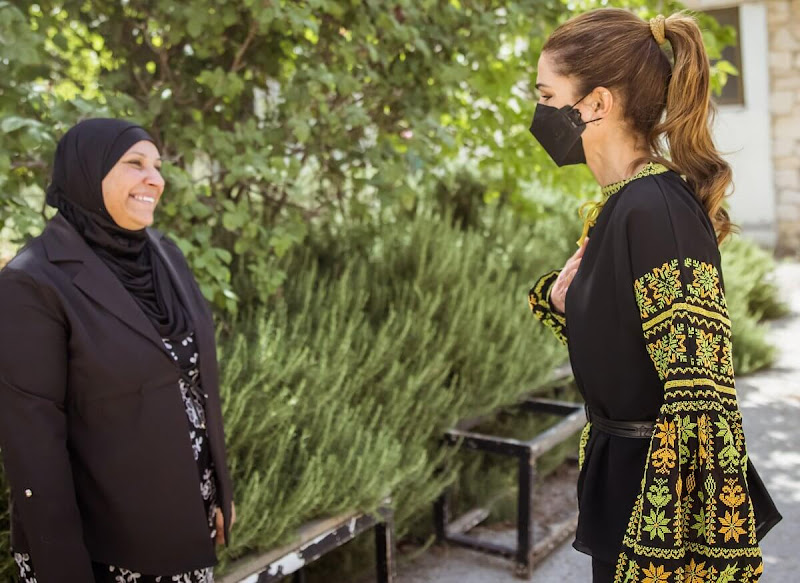 Queen Rania wore a palestinian embroidery blouse.  Palestinian embroidery blouse from Dar Noora. Black crepe peplum top