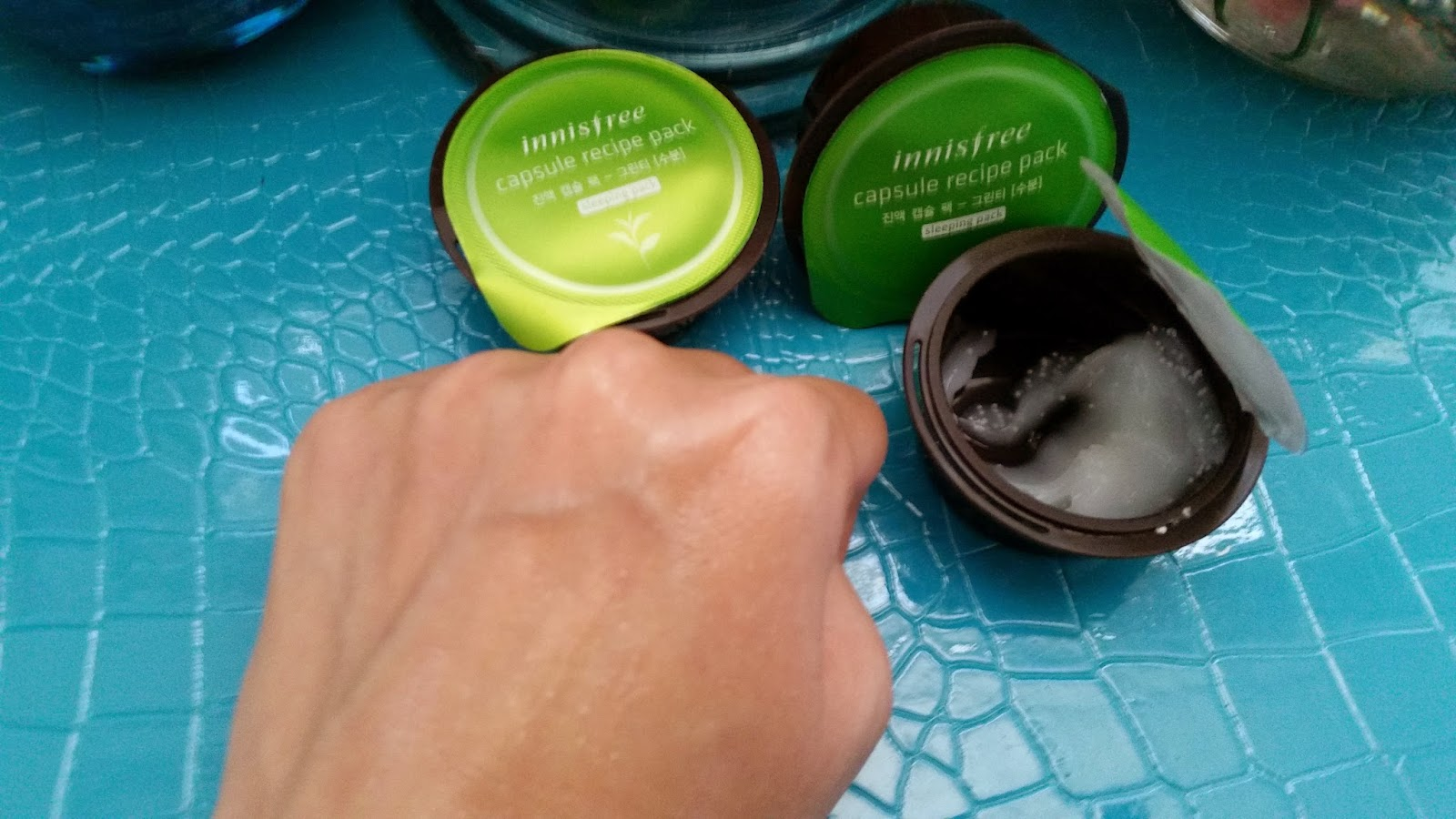 Green Tea Sleeping Pack massaged in on the back of hand.