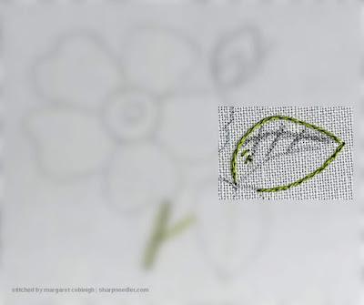 Leaf outlined in split stitch