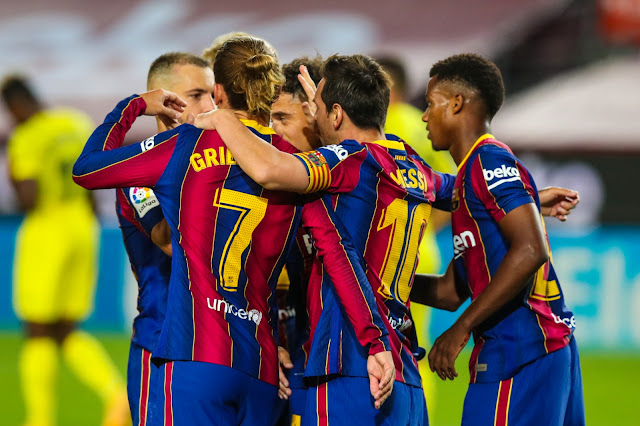 Lionel Messi celebrates with Barcelona players after Ansu Fati scores against Villareal
