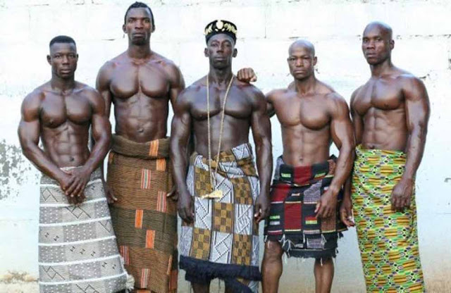 5 dark coloured African men with cloth wrapped around their waist