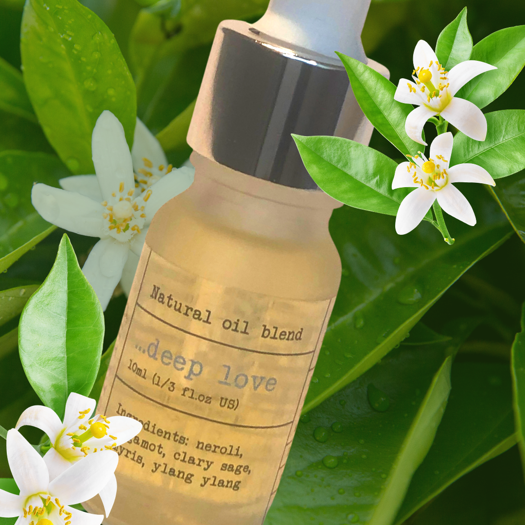 natural essential oil blend from Perfino in scent Deep Love surrounded by white flowers