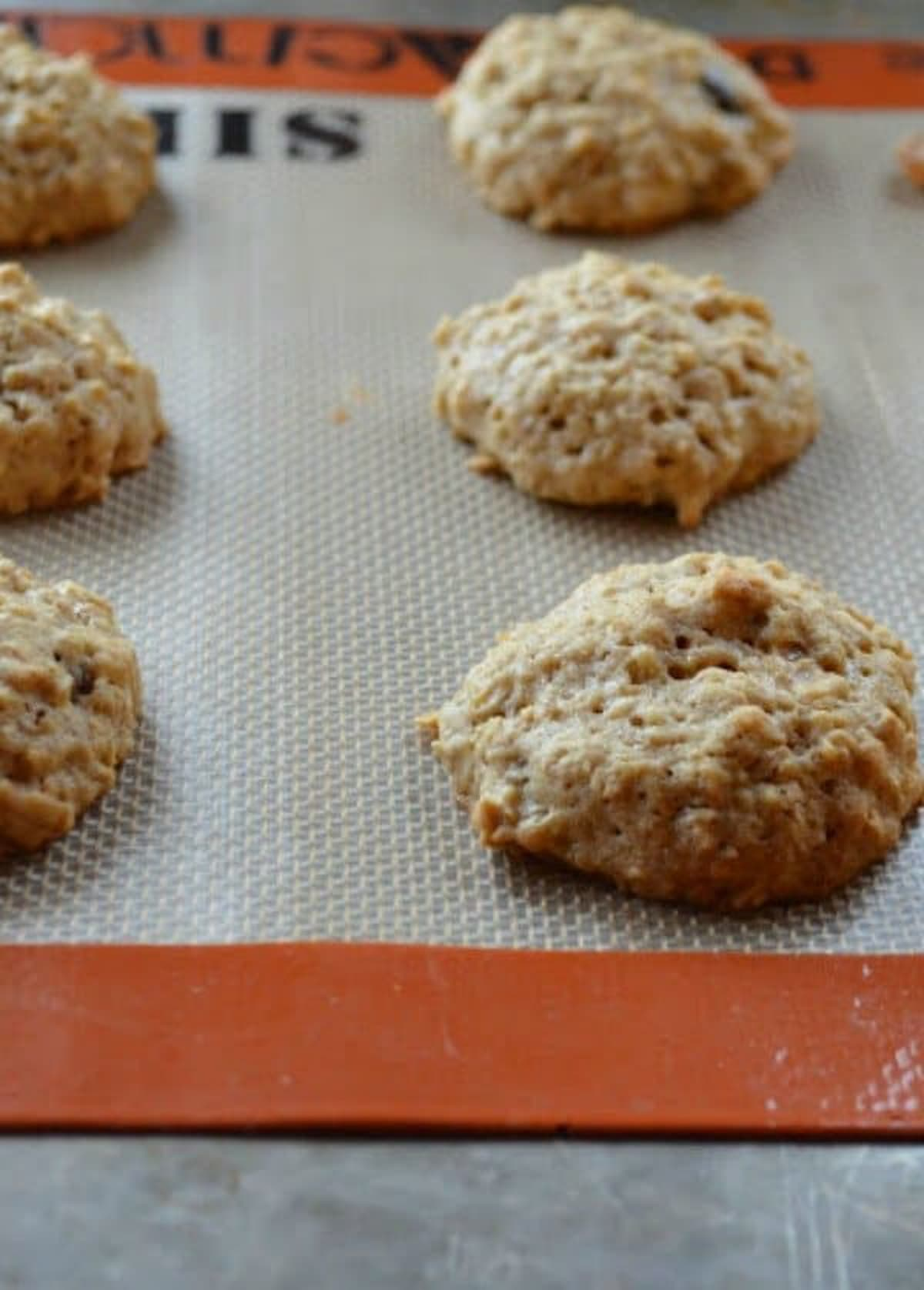 Chewy Spiced Oatmeal Raisin Cookies on Silpat lined baking sheet from Serena Bakes Simply From Scratch.