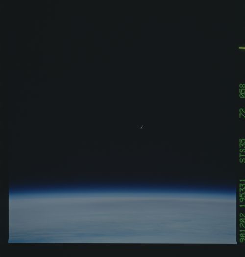 New image of space UFOs or space debris or junk image number STS035-72-58.