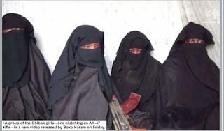 chibok girl holding AK-47