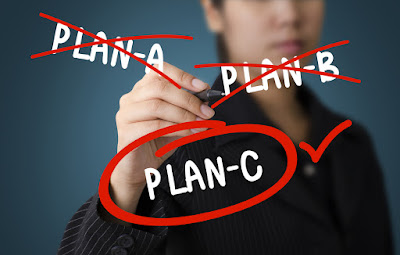 A business man has crossed out Plans A & B in favor of Plan C