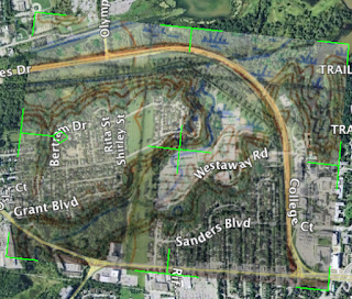 Ariel map of west campus McMaster University parking lot with superimposed hitsorical topical terrain mapping showing where Coldwater Creek used to flow before the parking lot was built