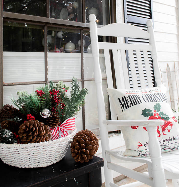 white porch rocker with Christmas pillow