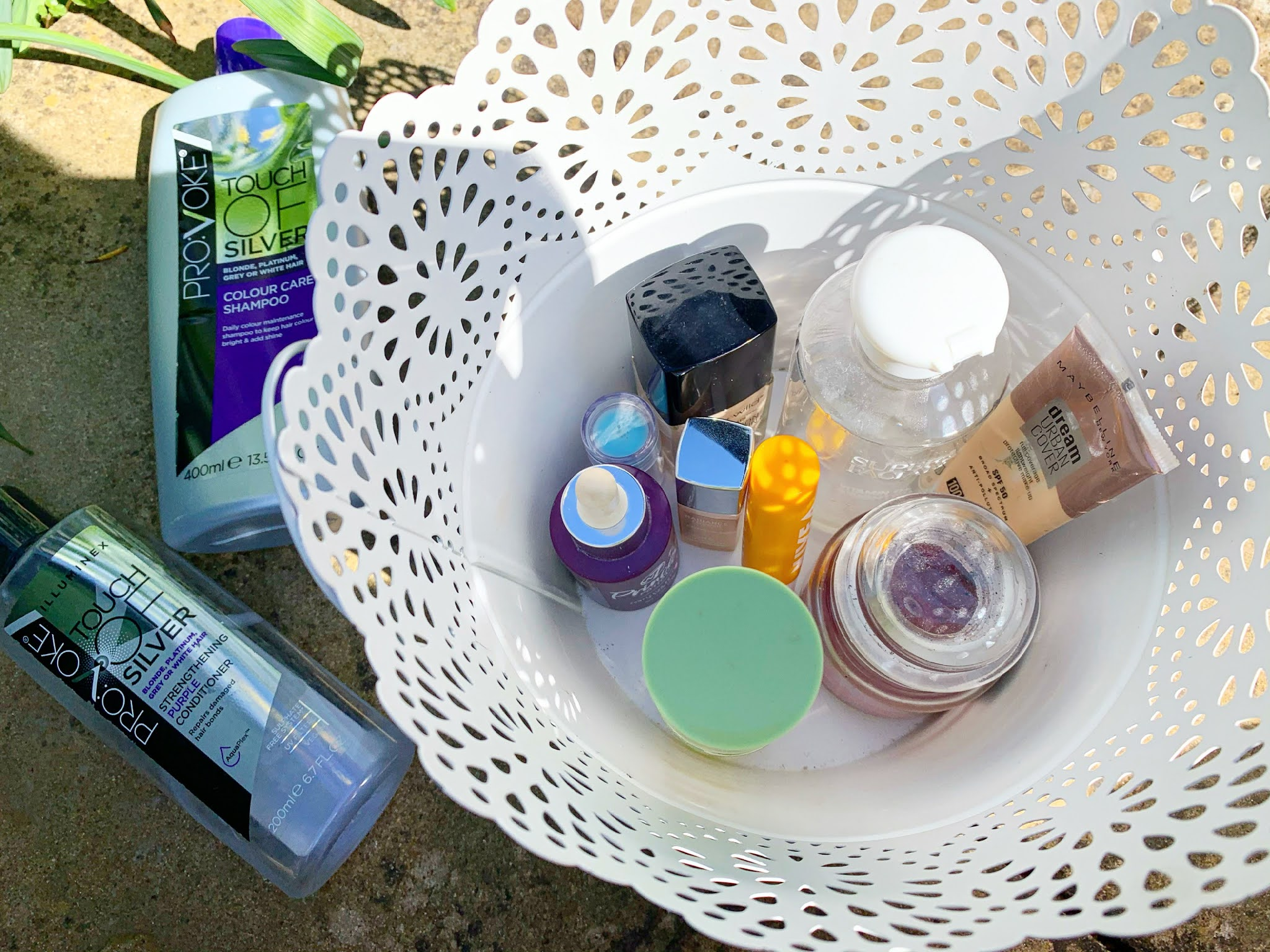 Empty makeup and skincare products in a tub