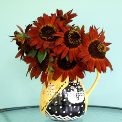 Magnificent Autumn Beauty Sunflowers in a Laurel Burch Cat Vase