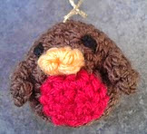 http://www.ravelry.com/patterns/library/little-robin-christmas-tree-decoration