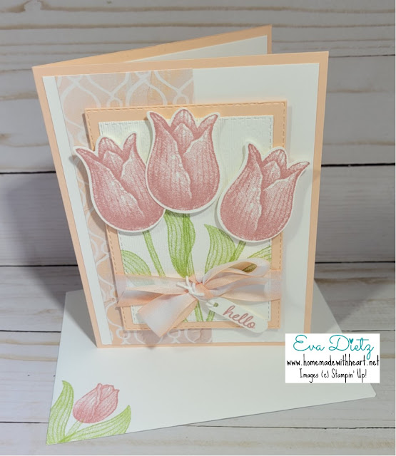 Three pink tulips tied with a pink bow on a multi layered card