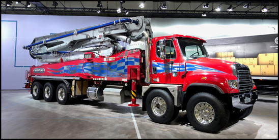 The Freightliner 114SD with a concrete pumper body on display at the IAA