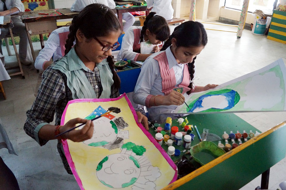 Students making posters during World Environment Day celebrations at Green Land Convent School