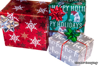 Cramer Imaging's professionally photographed quality still life photo of three brightly colored and stacked Christmas gifts or packages