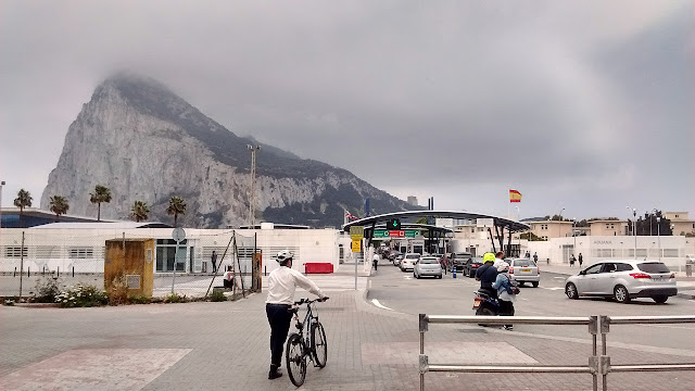 Photo of the border crossing facility between La Linea de la Concepcion, Spain, and the British territory of Gibraltar, including everyday vehicle and foot traffic.