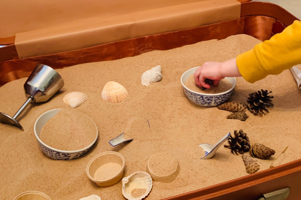 Using the curiosity approach at home  - sand pit in an old suitcase