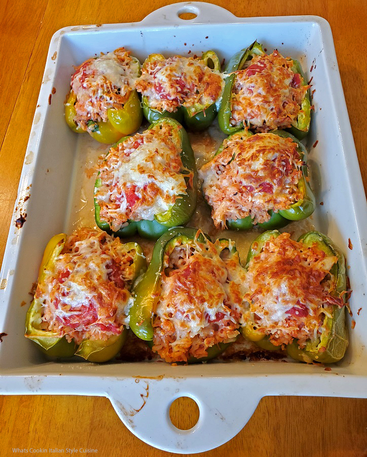 this is a casserole of stuffed bell peppers the filling is chicken rice and topped with cheese