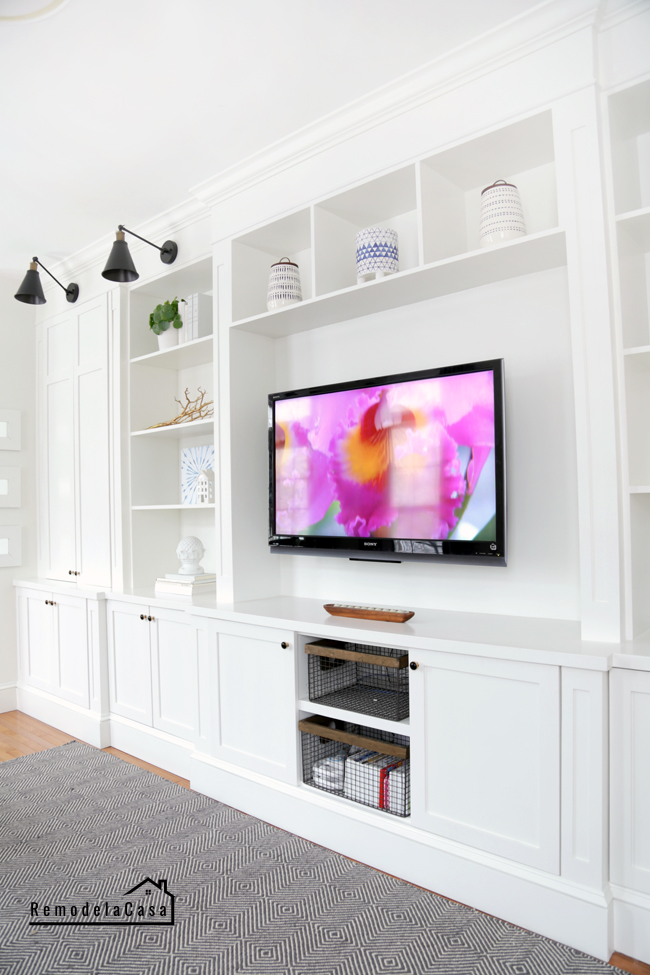 Long wall of built ins around TV