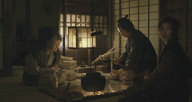 Hiroyuki Sanada as Samurai Iguchi making Insect cages with his eldest daughter to make ends meet