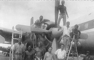 Mercenaries refitting a Biafran Invader B-29 medium bomber