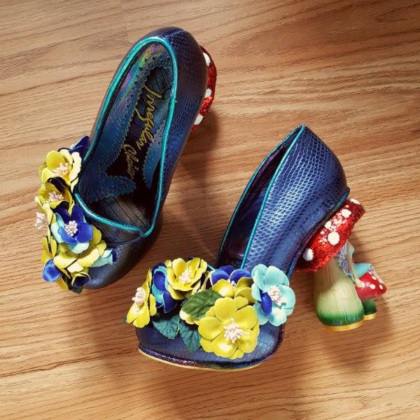 blue Irregular Choice fairy toadstool shoes lying on floor