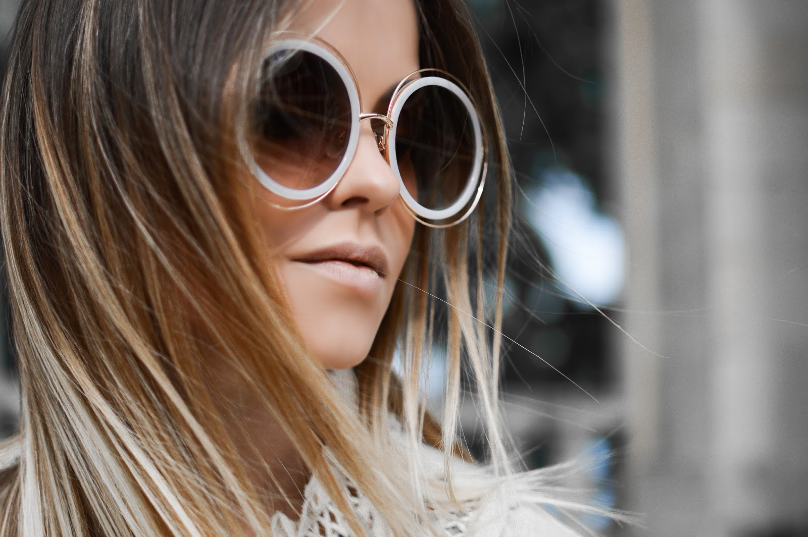 woman with long hair wearing sunglasses