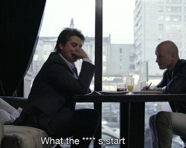 """Two people talking at a table with a subtilte that says """"What the **** s start"""""""
