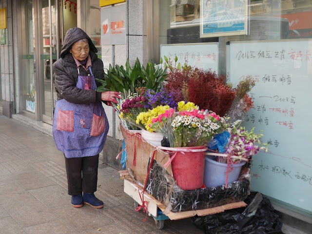 woman selling flowers from a cart in Hongkou, Shanghai
