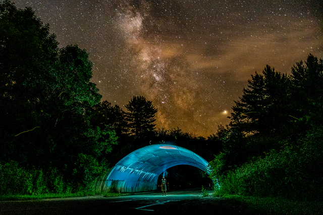 Took a picture of the Milky Way while my girlfriend stood in an underpass with a headlamp looking up (edited in Lightroom). Devil's Lake State Park, Wisconsin.