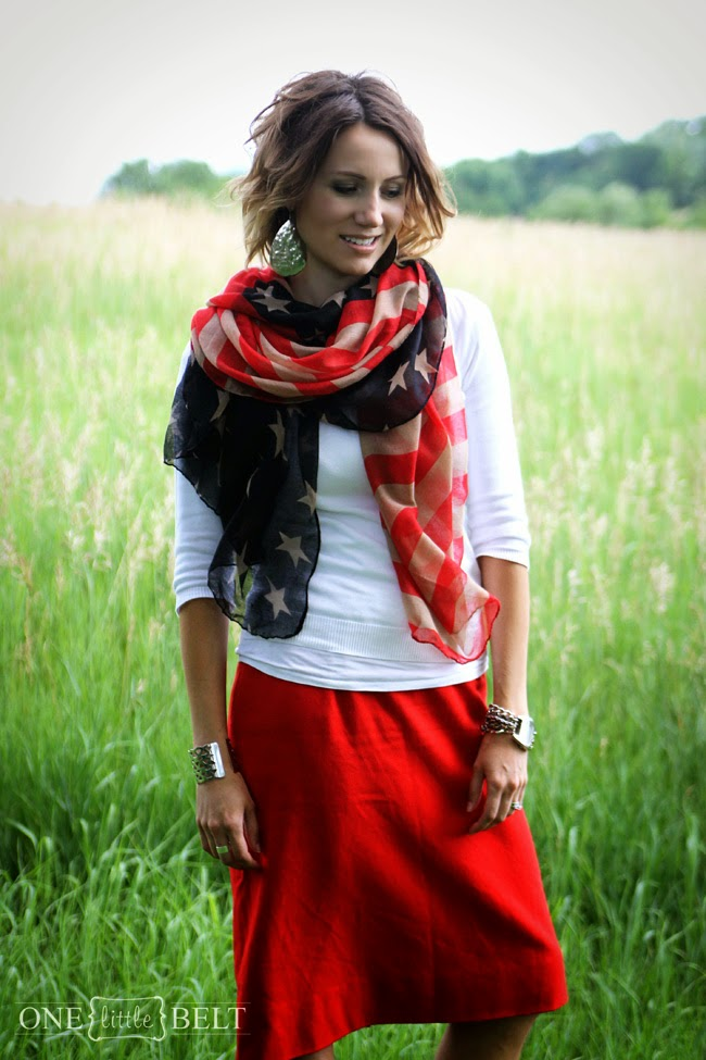 Flag scarf, white sweater, red skirt