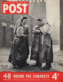 Four women in work clothes standing on a street gossiping - magazine cover