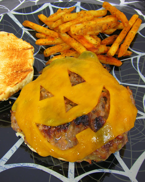 Jack-O-Lantern Cheeseburgers - fantastic homemade Ranch burgers topped with a fun Halloween cheese cut out. Cut out a jack-o-lantern face in the cheese for a festive halloween burger!