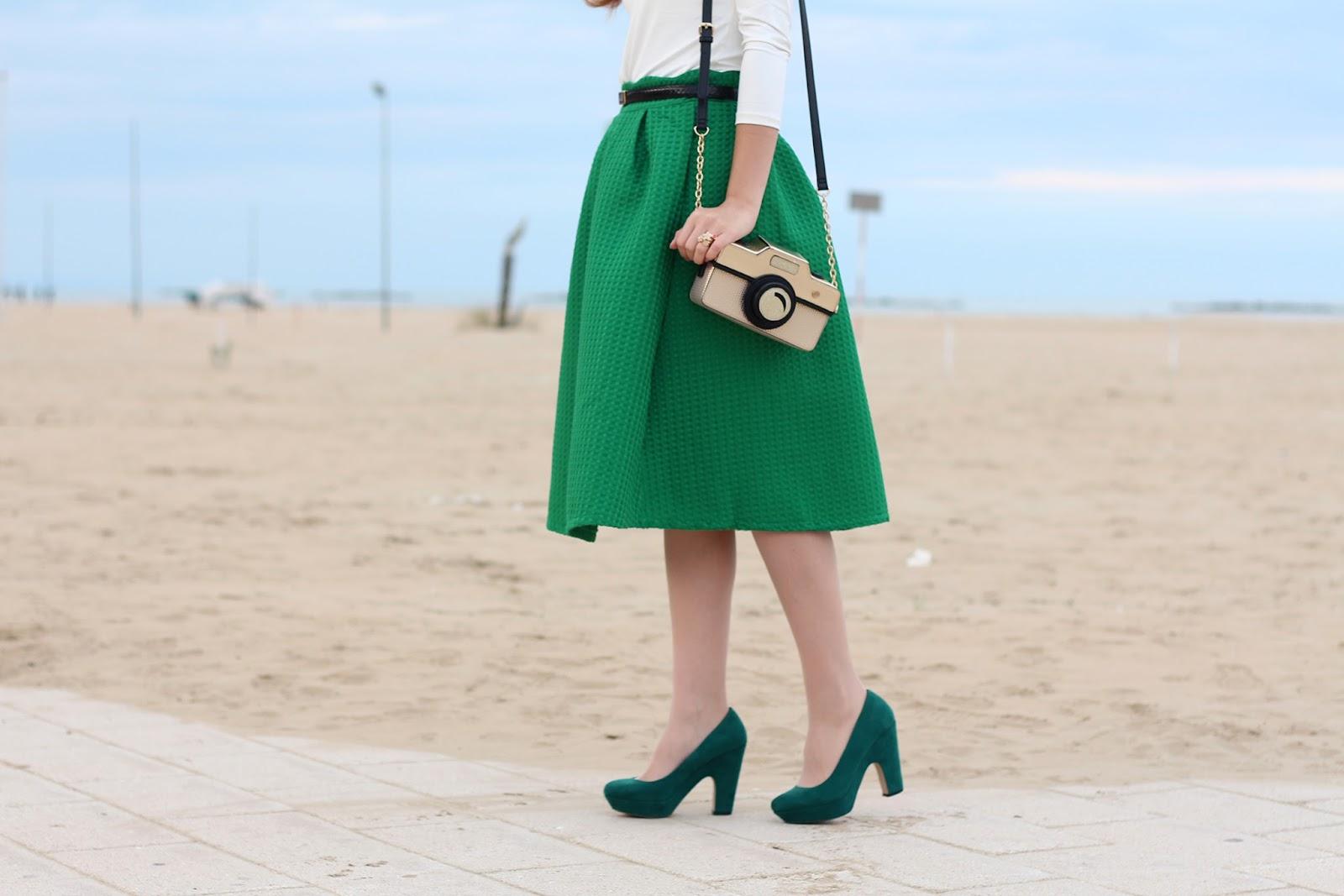 green midi skirt accessorize camera bag shoes heels pumps