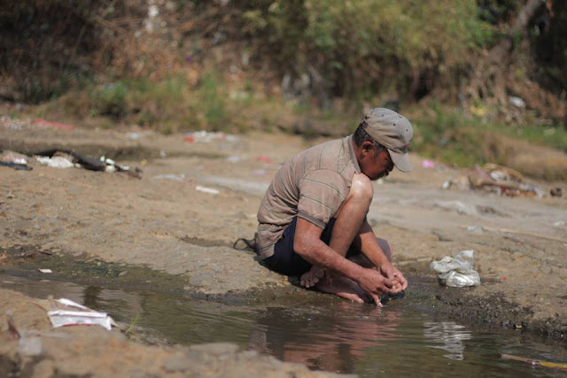 Fish Catcher In Ciliwung River
