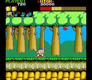 Captura de pantalla del arcade Wonder Boy, SEGA, Westone, 1986. Muestra a Wonder Boy haciendo skate