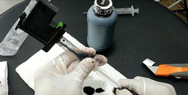 Sacando tinta del cartucho Canon