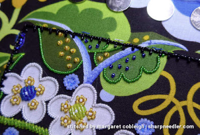 Detail of royal blue beads added to leaves at top of Wild Child. (Wild Child Japanese Bead Embroidery by Mary Alice Sinton)