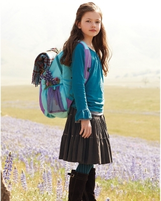 1bfa86d5f6 About this Spot  Mackenzie Foy wore Garnet Hills Kids Backpack for  advertising
