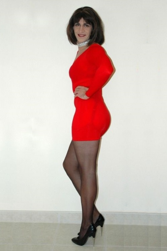 Crossdresser in red mini dress, black pantyhose and black high heels