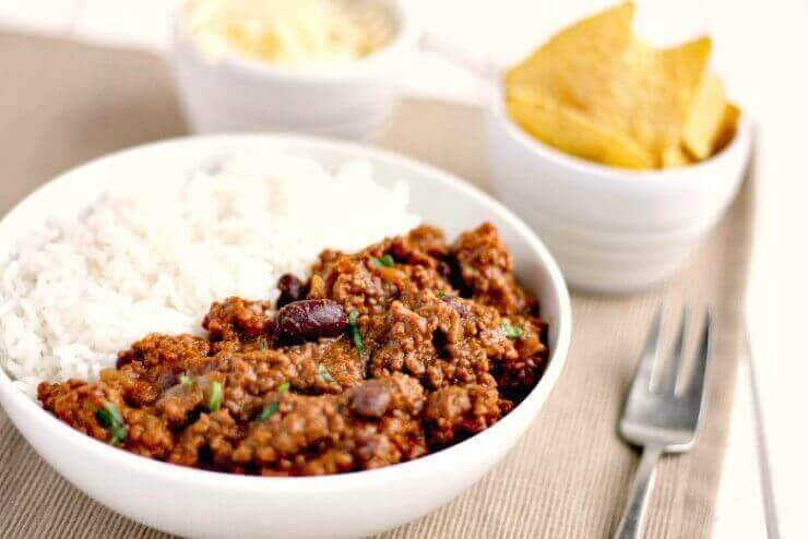 Slow Cooker Chilli Con Carne with rice and grated cheese