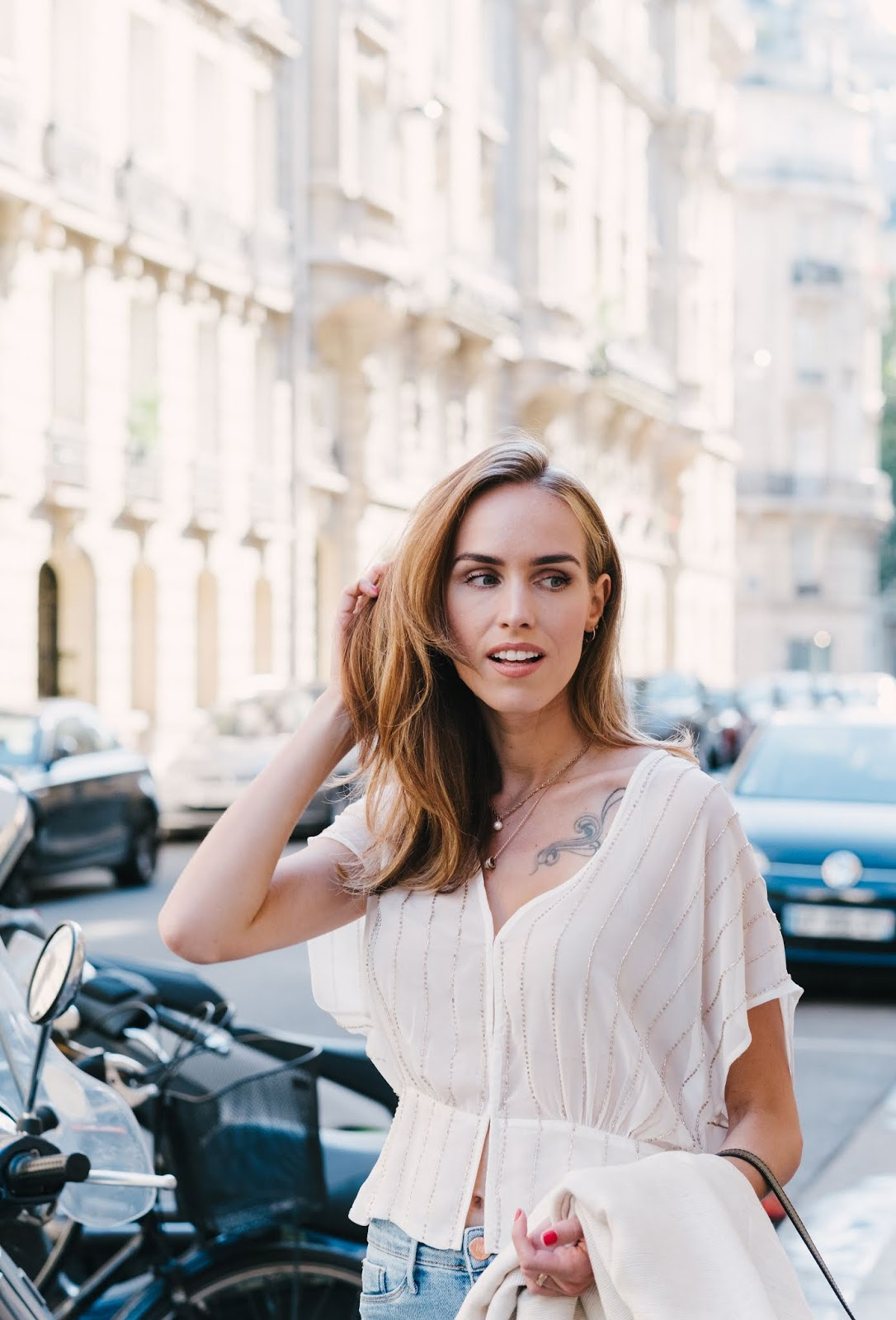 parisian street style outfit summer white pearl top