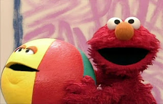Elmo and the beachball start bouncing together. Elmo's World Balls Interview