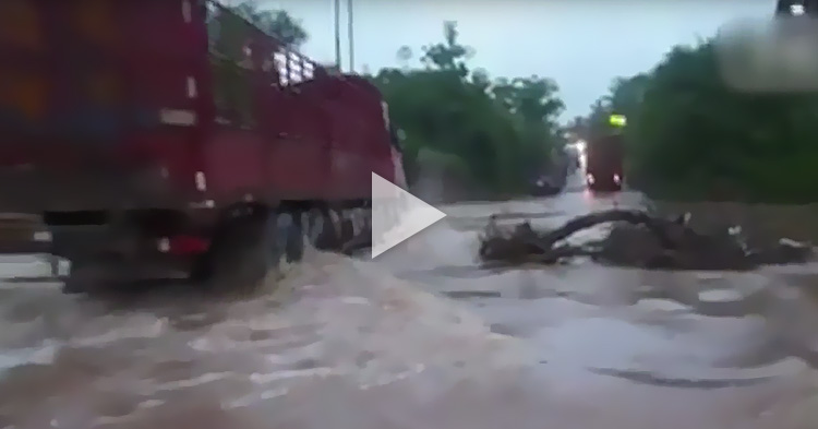 Truck driver engulfed by a massive flood in China