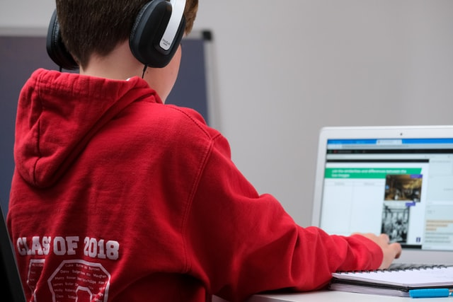 Boy with headphone and laptop