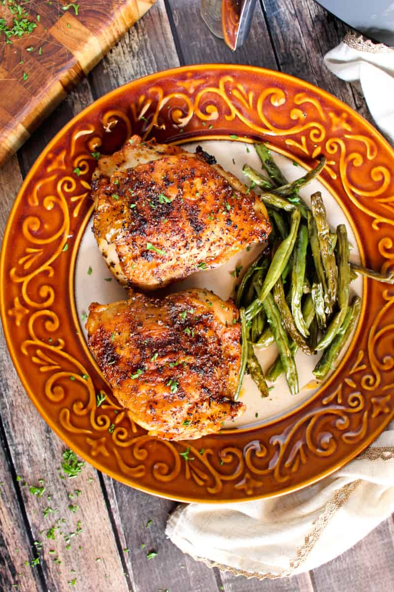 The Best Air Fryer Chicken Thighs are super juicy inside with extra crispy seasoned skin. Once you try them, you will never want to cook them any other way! #airfryer #chicken
