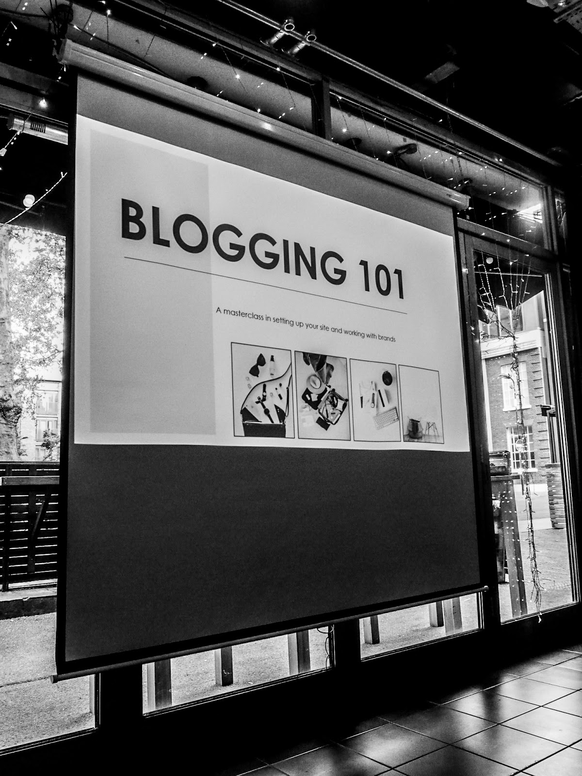 A projected screen in a low light room showing the words, 'blogging 101'