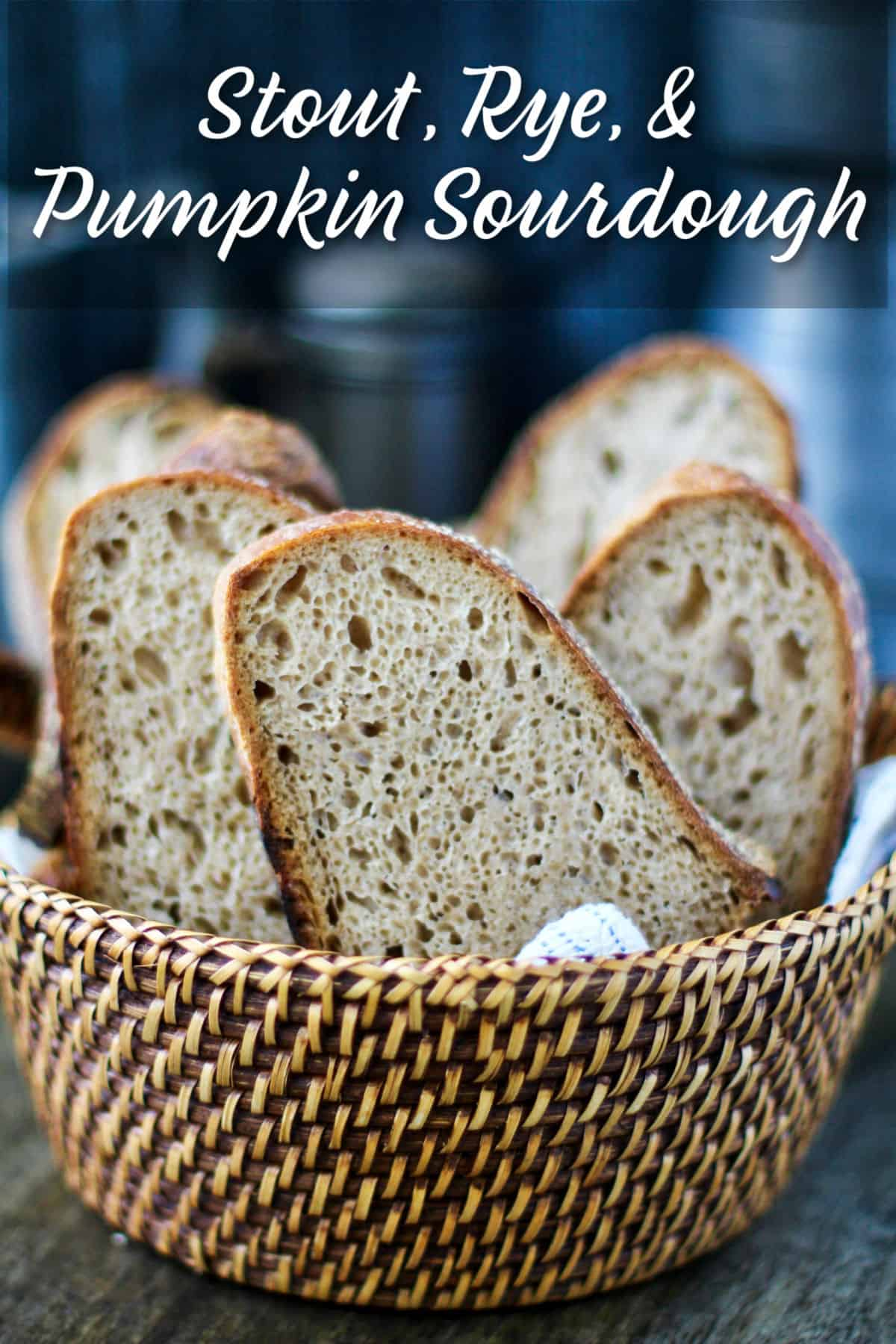 Stout, Rye, and Pumpkin Sourdough slices in a basket.