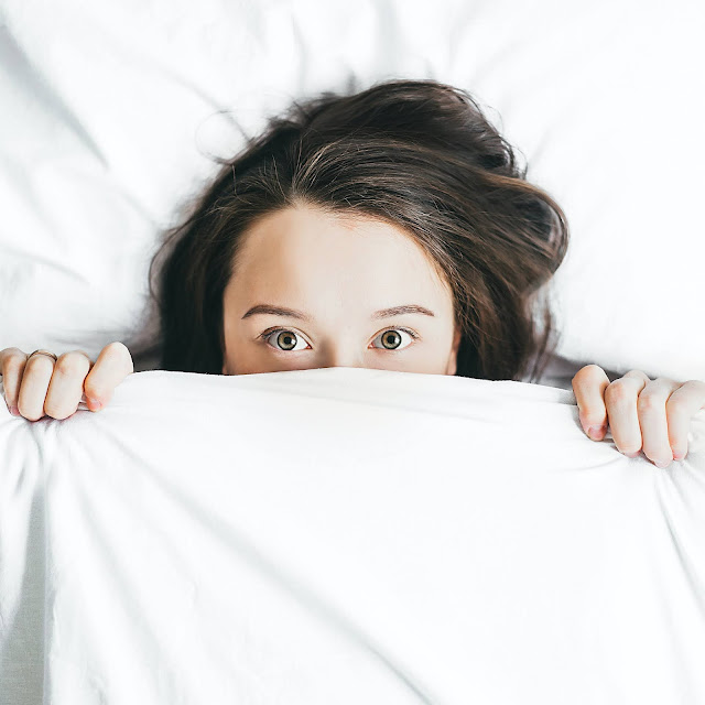 "woman peeking from bedclothes <span>Photo by <a href=""https://unsplash.com/@alexagorn?utm_source=unsplash&amp;utm_medium=referral&amp;utm_content=creditCopyText"">Alexandra Gorn</a> on <a href=""https://unsplash.com/s/photos/bed?utm_source=unsplash&amp;utm_medium=referral&amp;utm_content=creditCopyText"">Unsplash</a></span>"